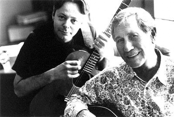Tommy Emmanuel (left) & Chet Atkins (right).  Two of the all-time greatest fingerstyle guitarists.  Circa 1997.